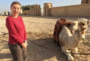 New Equations teacher Jenna with Camel in Egypt for Happiness Page