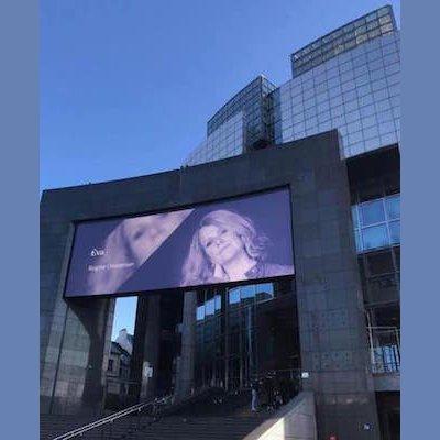 Birgitte Christensen's face on a billboard outside of the Paris Opera House