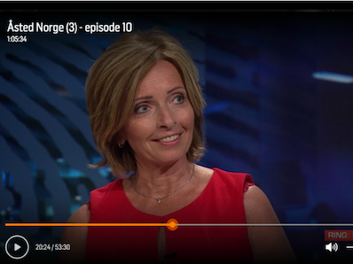 Hanne Kristin Rohde smiling on a paused TV
