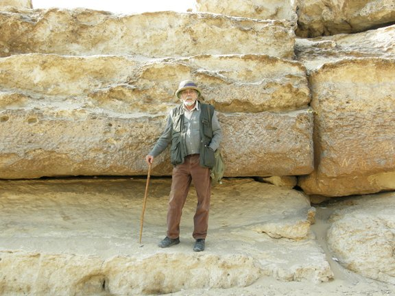 John Anthony West standing on giant stones in Egypt