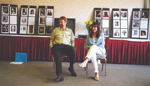 Siska Tovey and Alan Sheets sitting in front of a room teaching