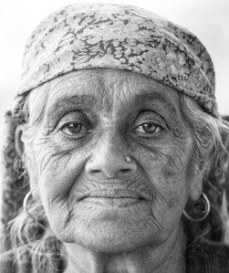 A 5 old woman with a peaceful expression